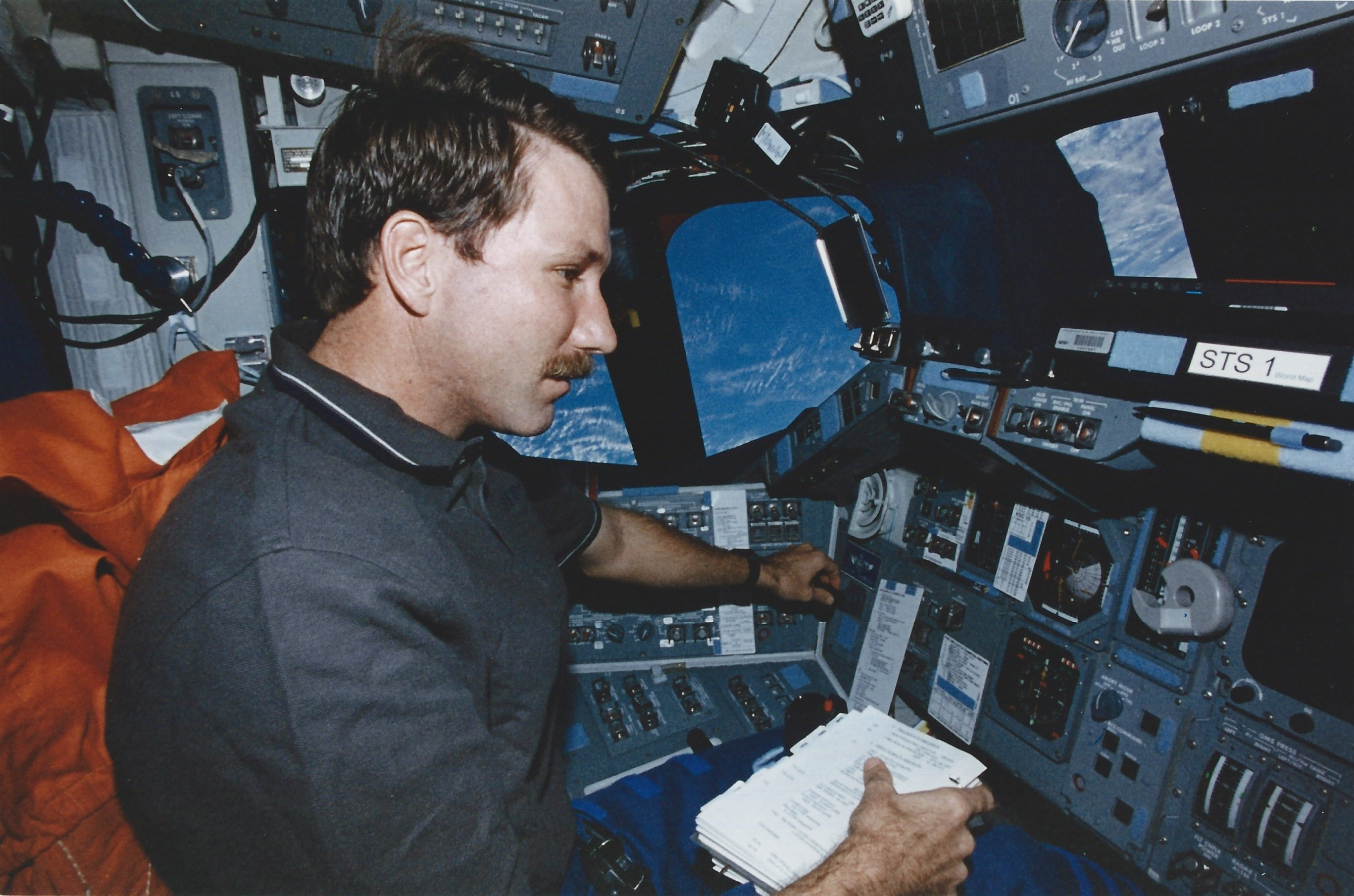 Columbia's pilot, Kent Rominger, runs the rendezvous checklist from the commander's seat as we close in on one of our satellite targets. (NASA STS080-341-032)