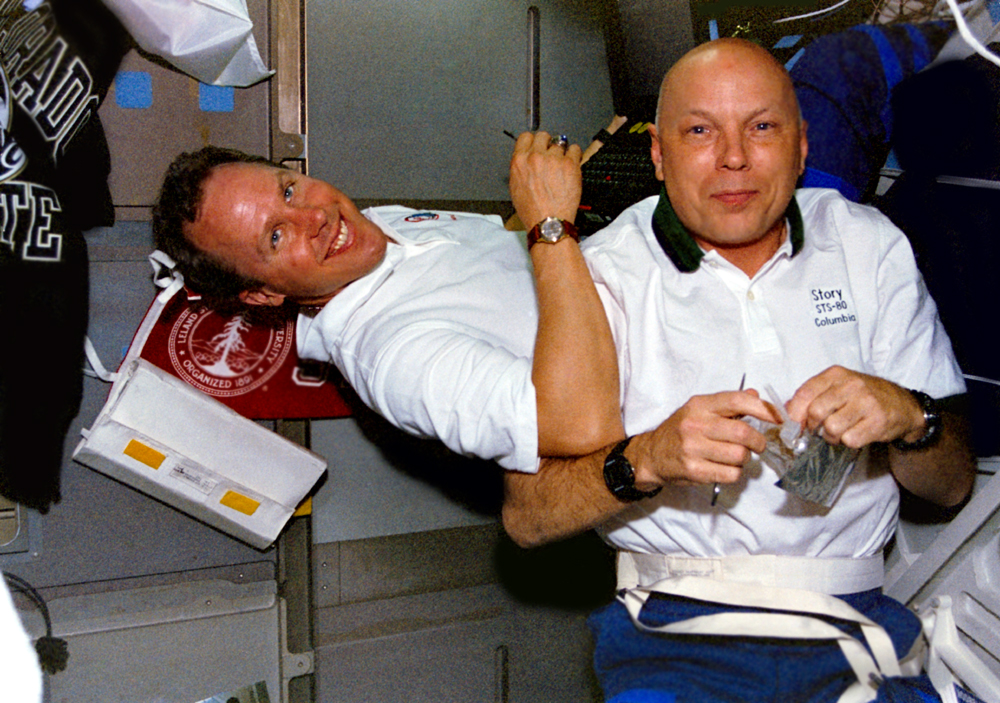 Tom Jones and Story Musgrave hanging out on Columbia's middeck. (NASA STS080-312-019B)