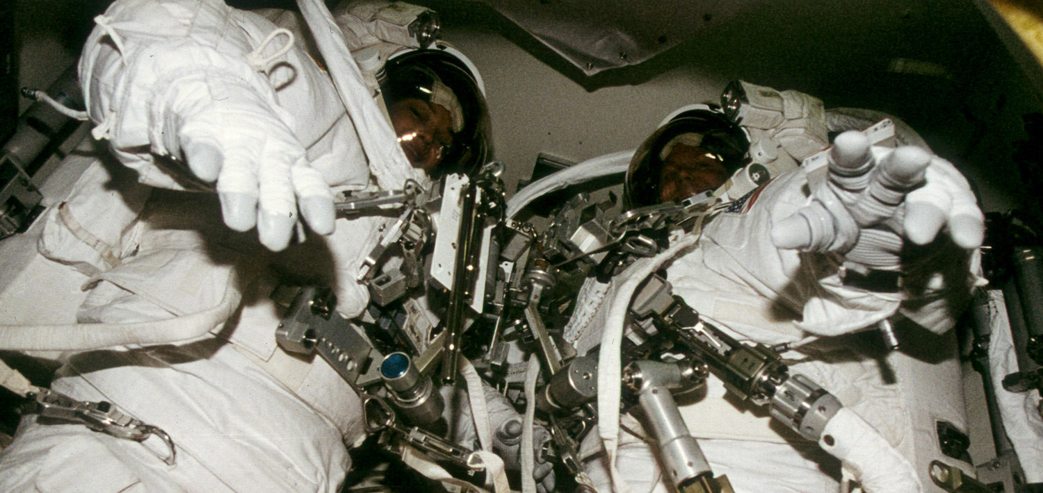Tammy Jernigan (L) and Tom Jones fully suited in Columbia's airlock prior to EVA 1 on flight day 10, Nov. 28, 1996. The EVA was cancelled after a loose screw jammed the airlock outer hatch. (NASA)