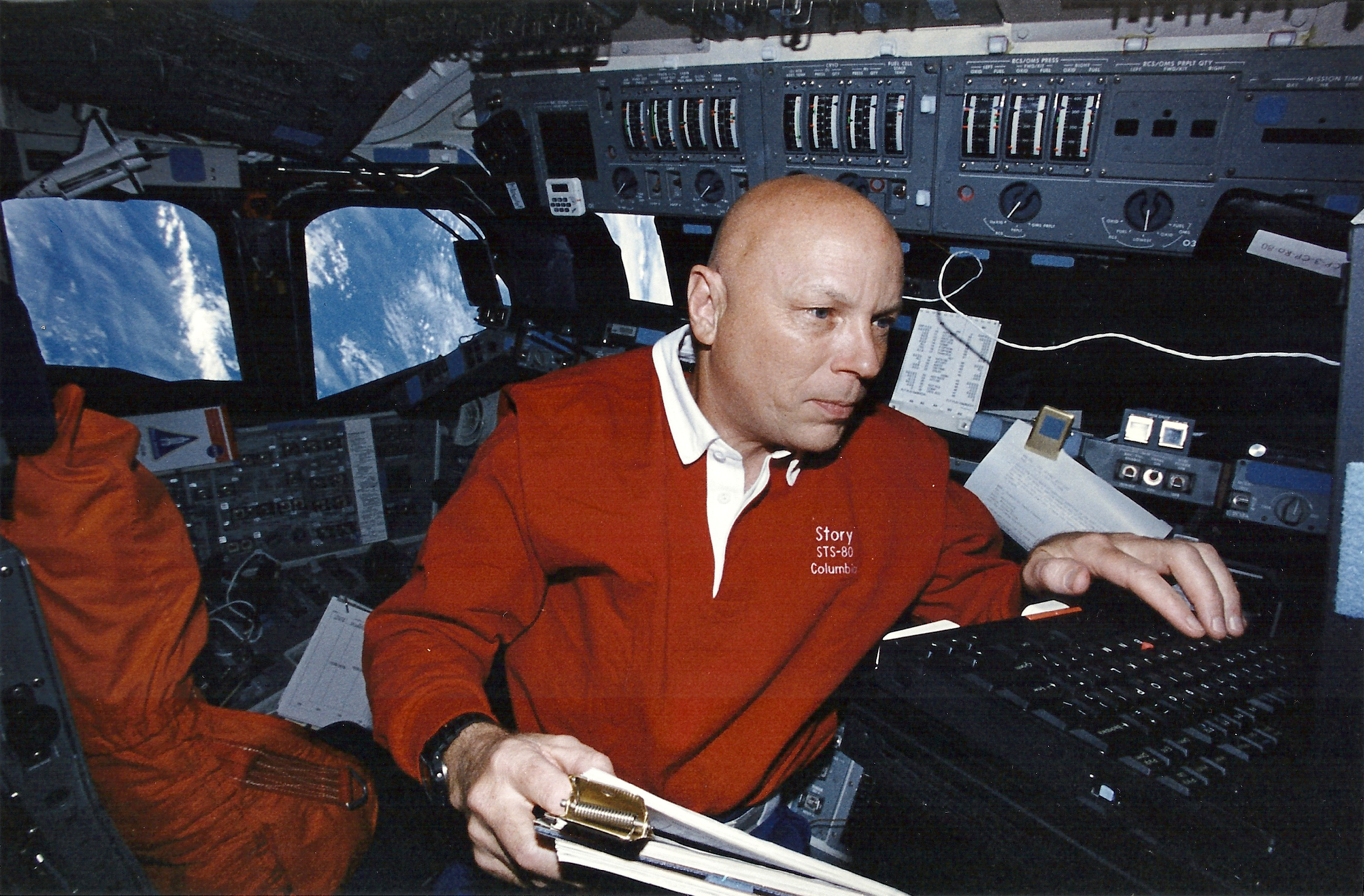 Story Musgrave monitors the health and status of the Wake Shield Facility-3 spacecraft from Columbia's flight deck. (NASA STS080-326-018)