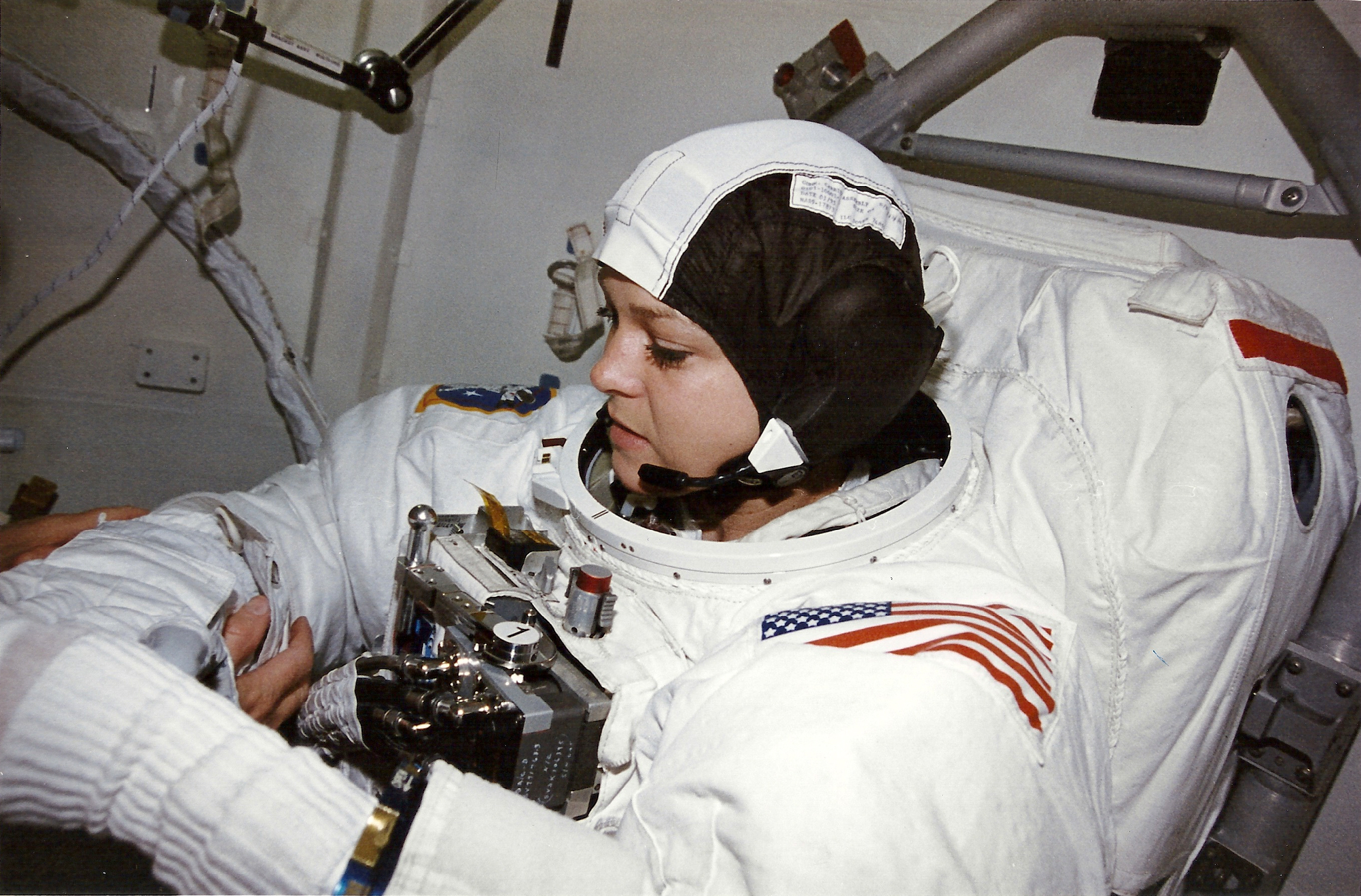 Mission Specialist Tammy Jernigan (PhD) readies for the first of two spacewalks planned on STS-80 (NASA sts080-312-027)